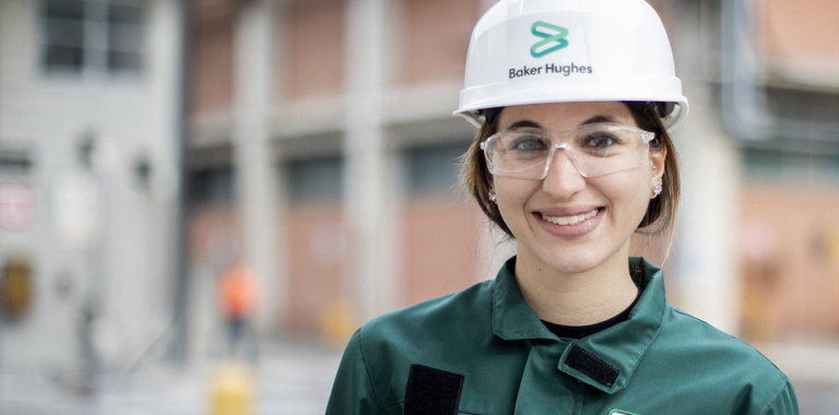 Portrait of a Baker Hughes employee wearing protective gear