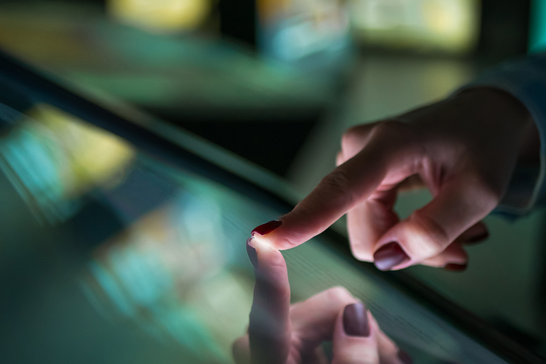 Index finger touching touchscreen